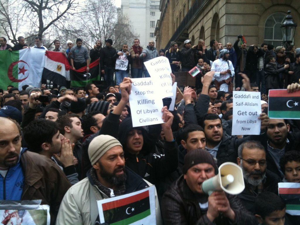 Libya protestors urge action from London in the days before intervention. The public is split on the choice to intervene in the country.
