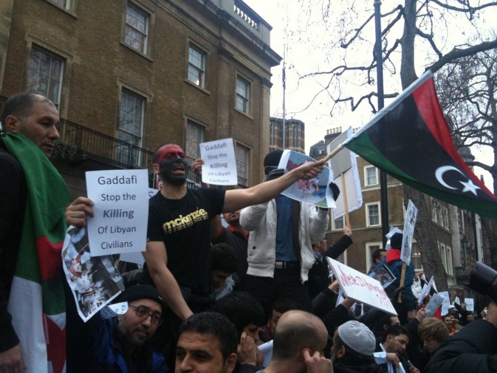 Libyan exiles protest in London. Many want a tougher internatiional response to the violence.