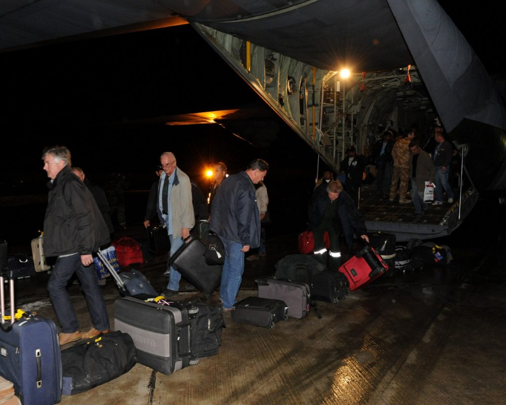 British oil workers rescued by two RAF Hercules transport aircraft arrive in Malta
