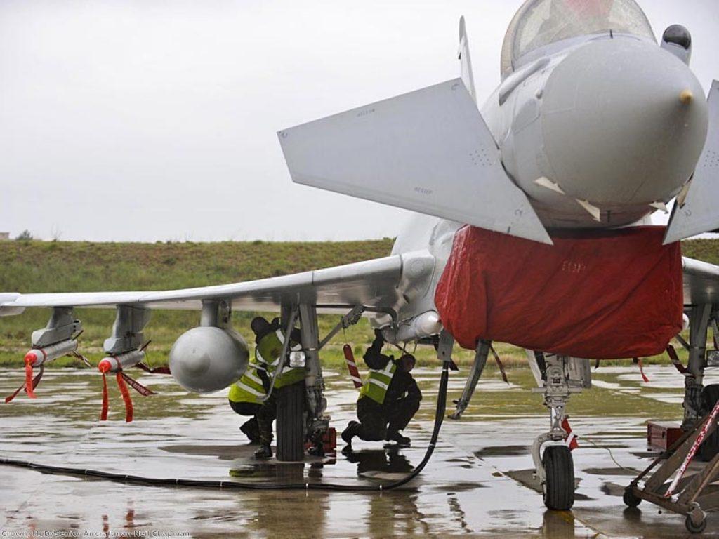 RAF ground crew prepare a Typhoon jet.