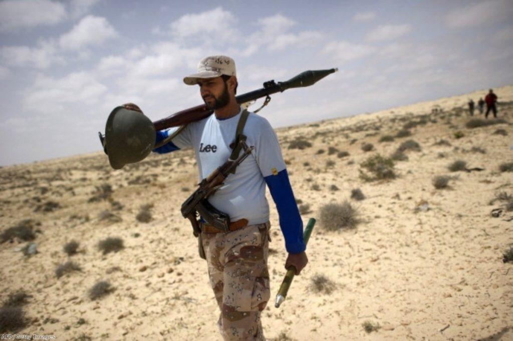 A Libyan rebel walks through the desert. Photo: AFP/Getty Images