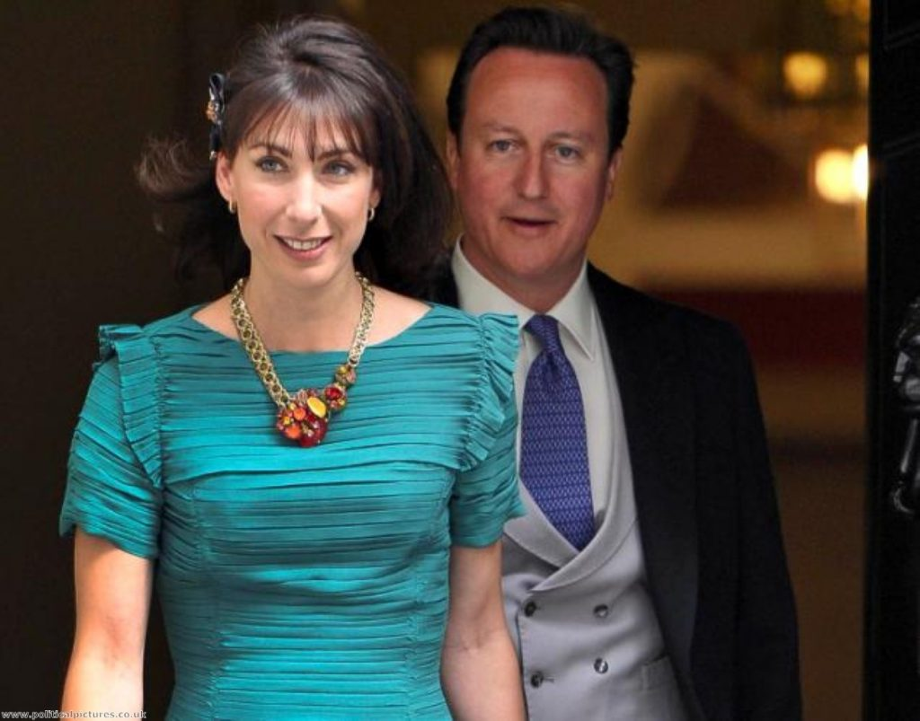 David Cameron and Samantha Cameron emerge from No 10 to attend the royal wedding