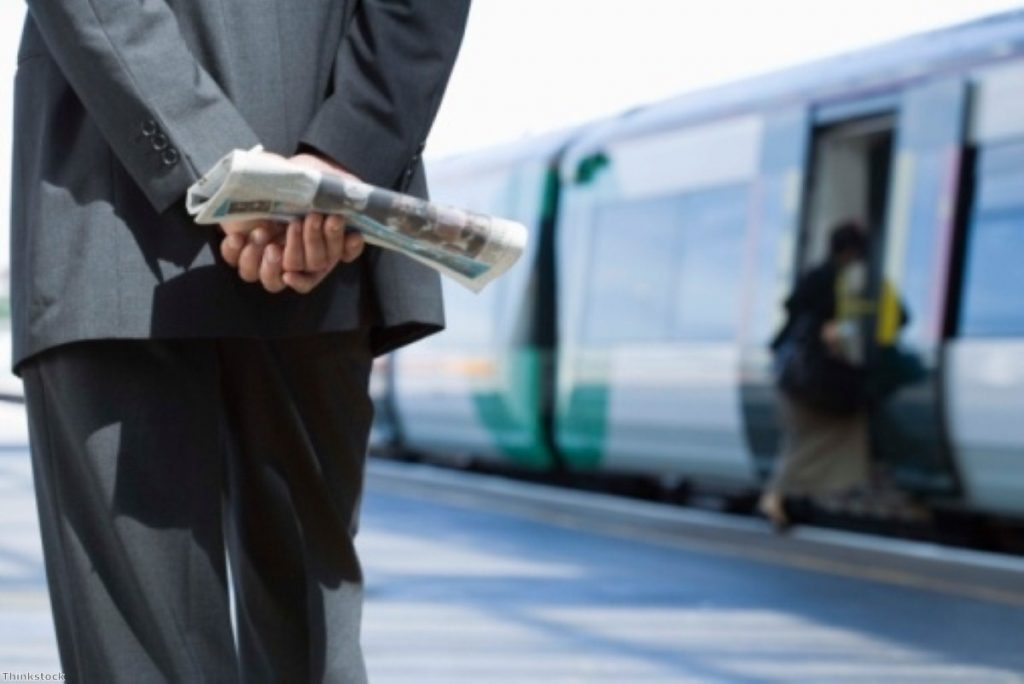 Businessmen on trains: The Department for Transport assumes they never work in transit.