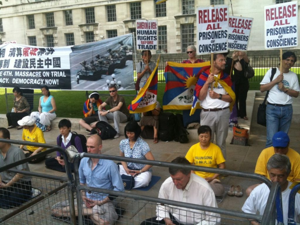 Free Tibet demonstrators meditate outside Downing Street during David Cameron's press conference with Wen Jiabao.