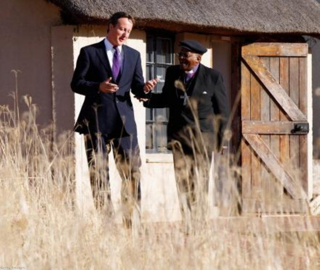 David Cameron with Archbishop Desmond Tutu in South Africa yesterday