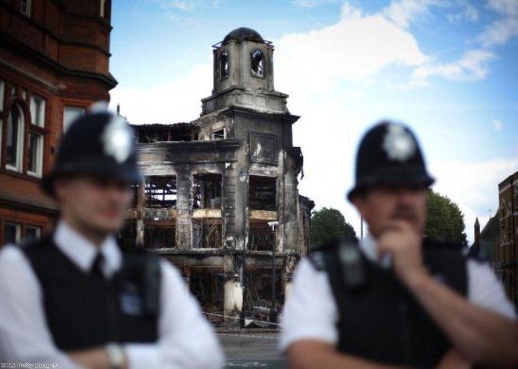 Police survey the damage in Croydon, south London