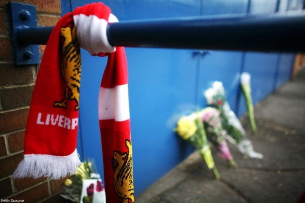 Tributes lie next to the Leppings Lane entrance of Hillsborough Stadium on the 20th anniversary of the Hillsborough disaster on April 14, 2009.