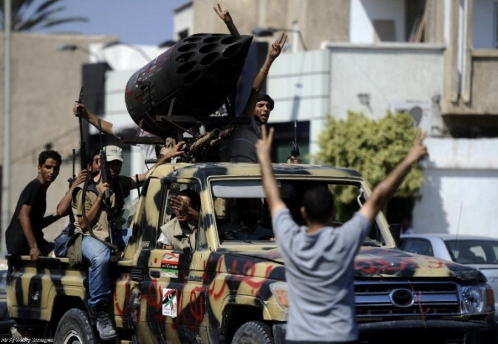Rebel fighters celebrate in Tripoli. The Commons was less animated