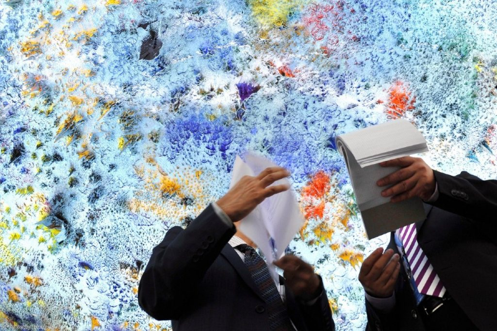 Delegates check their papers beneath a painted ceiling ahead of a UN Human Rights Council meeting on Syria earlier this month.