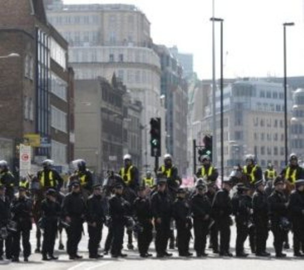 Police officers block a road in east London yesterday as the EDL gathered.