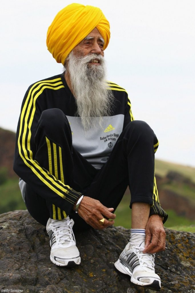 One hundred year old runner Fauja Singh, a Sikh, poses for pictures after being the first person to enter for 2012's Edinburgh Marathon.