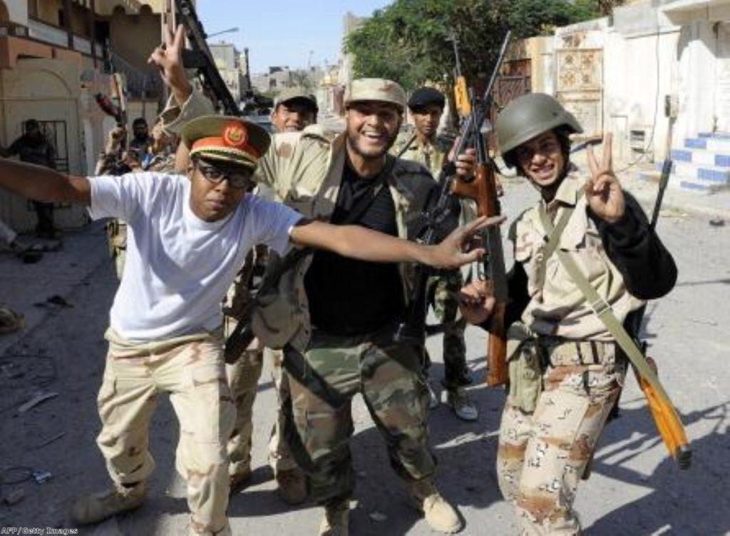 Libyan NTC troops celebrate Muammar Gaddafi's death