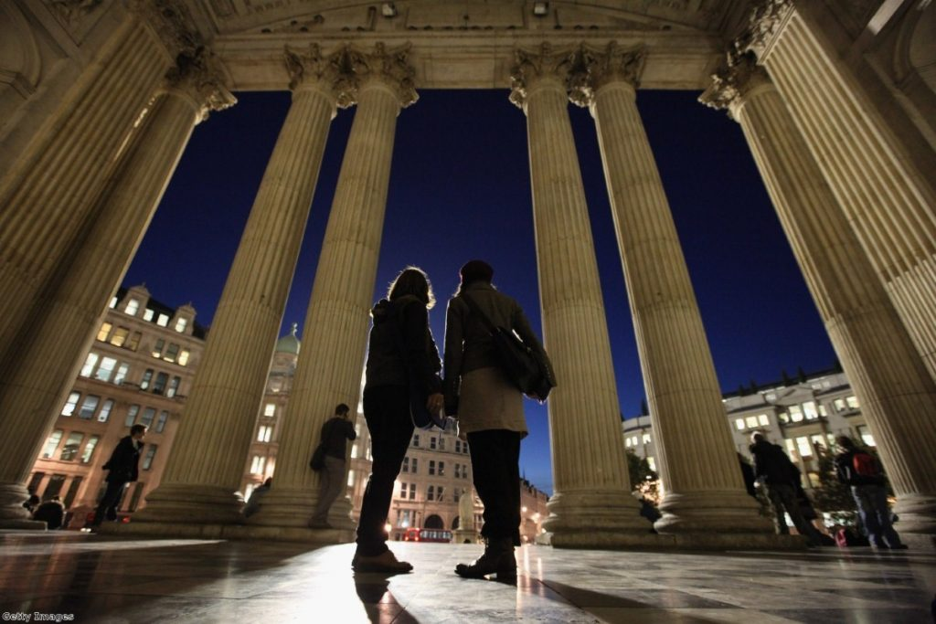 Two women stand outside St Paul's during the first Occupy protest.