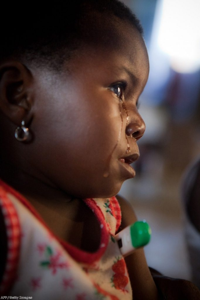 A refugee from Angola cries: The UK can do more to provide safe pasage