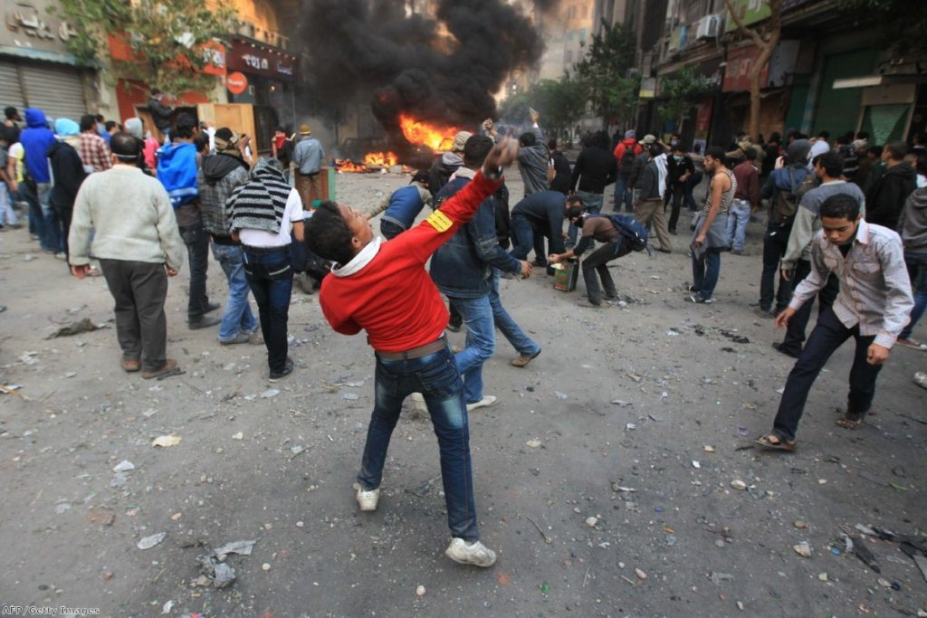 A young protestor during a demonstration in Egypt during the Arab Spring. David Cameron was criticised for travelling to the country with arms dealers after the revolution.
