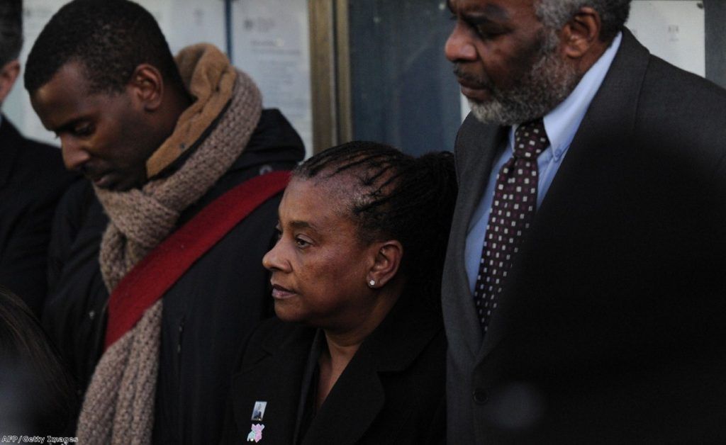 Stephen Lawrence's mother, brother and father in 2012 after his murderers' sentencing. They were subsequently spied on by Met undercover officers