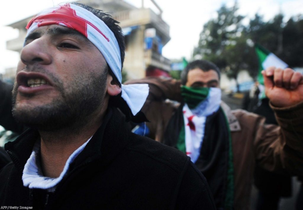 Men in Algeria chant slogans as they demonstrate over events in Syria. Many analysts believe north Africa is the new home of Islamic terrorism, but others are wary of mission creep in the region.