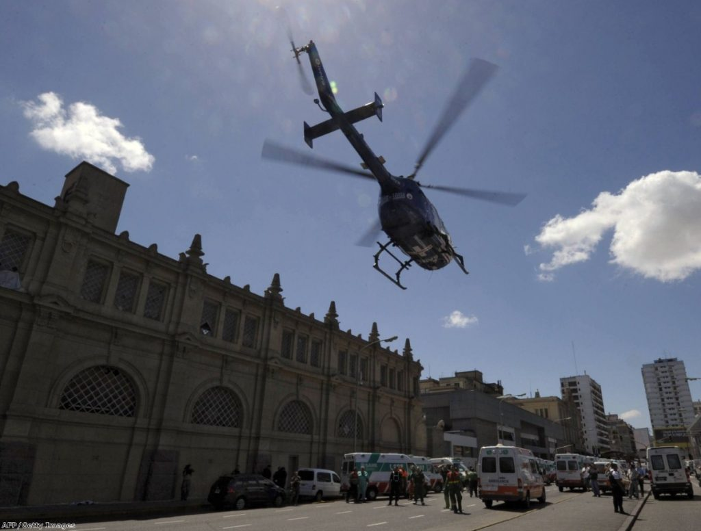 A helicopter transports injured people to a medical center after a train crashed at Once train station in Buenos Aires.