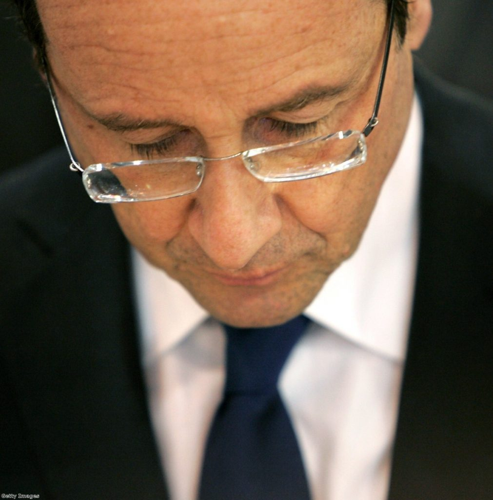 Francois Hollande visits the Paris International Farm Show yesterday. The challengers is ahead in the polls, but his lead is slipping.