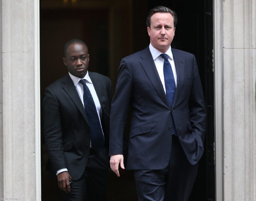 David Cameron leaves Downing Street with his private secretary Sam Gyimah as parliament is called back from recess.