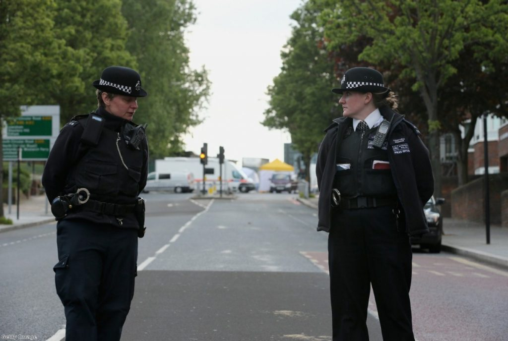 Police near to the scene in Woolwich following a major incident in which a man was killed