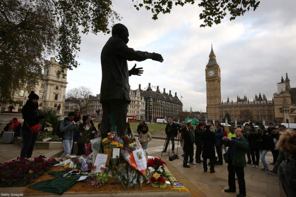 Crowds gather at Mandela's status in Parliament Square