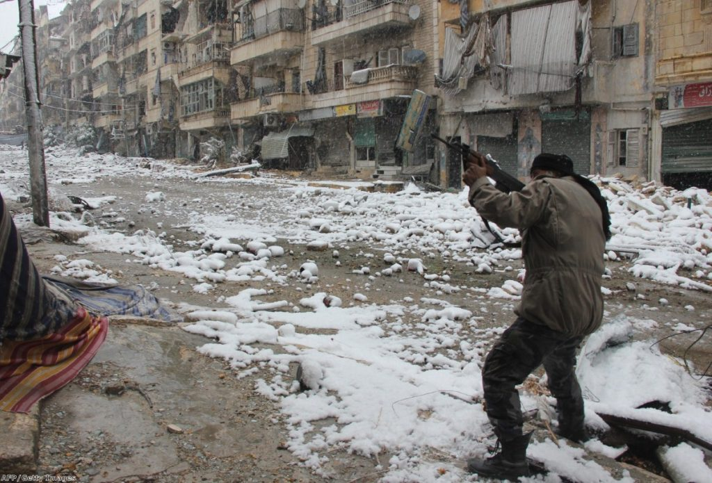 A rebel fighter aims his weapon during clashes with Syrian pro-government forces in the Salaheddin neighbourhood of Aleppo in 2013