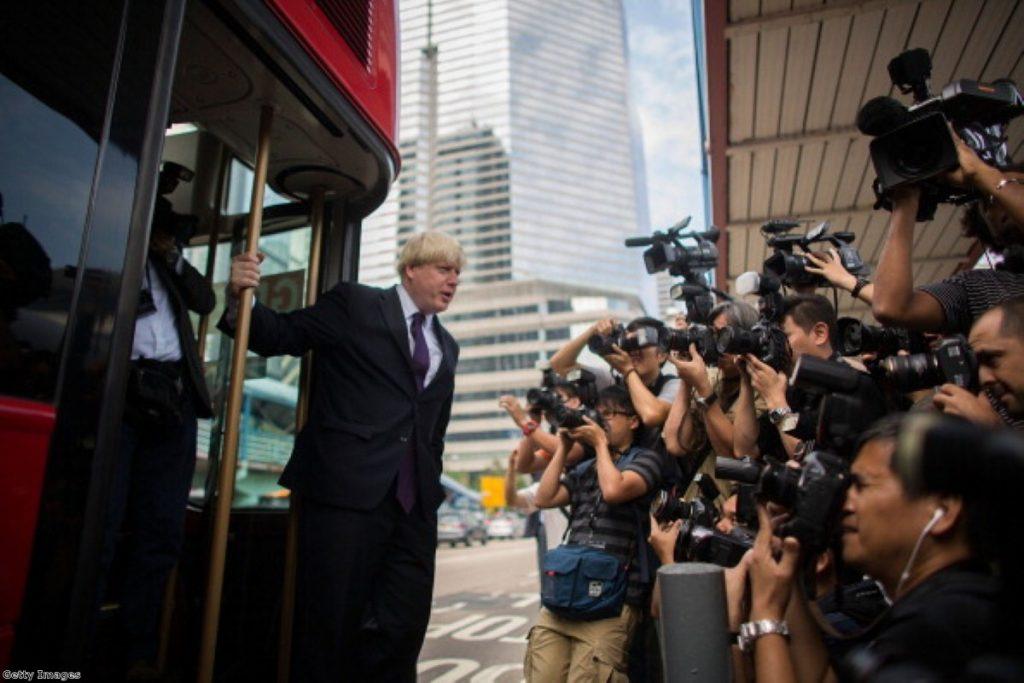 Boris Johnson shows off his new bus in Hong Kong.