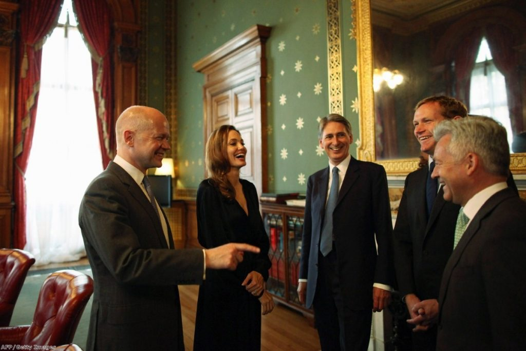 Angelina Jolie shares a joke with British ministers, but in the asylum system, her programme is being ignored