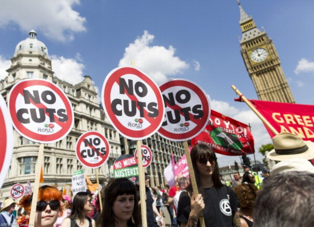 Anti-austerity campaigners march past Parliament last month.