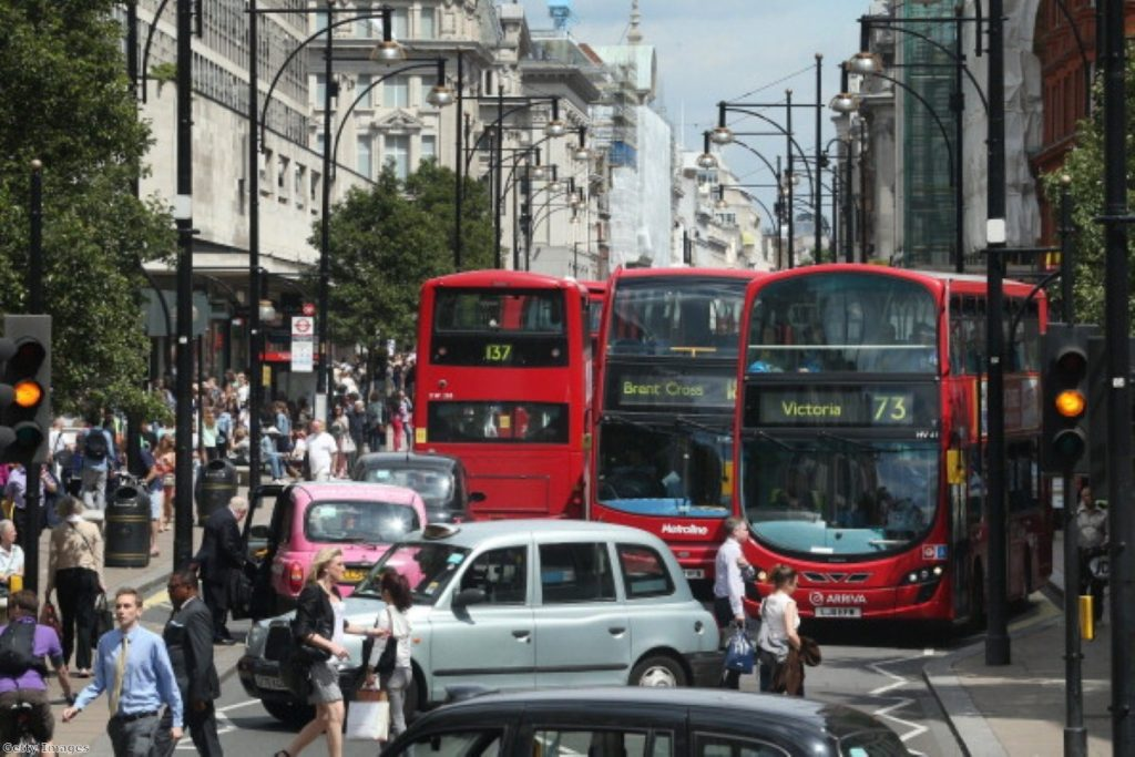 A wall of buses and taxis on London's Oxford Street.