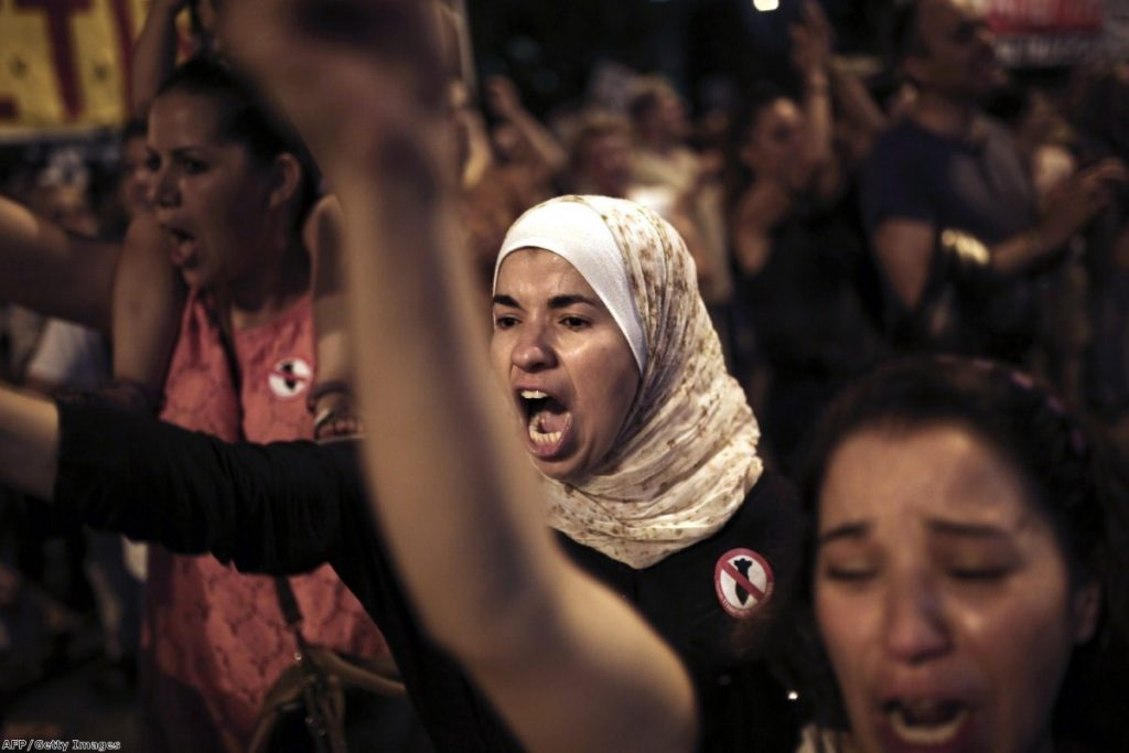 A protester shouts slogans outside the US embassy in Athens during a demonstration against Israel's offensive in the Gaza Strip on Thursday