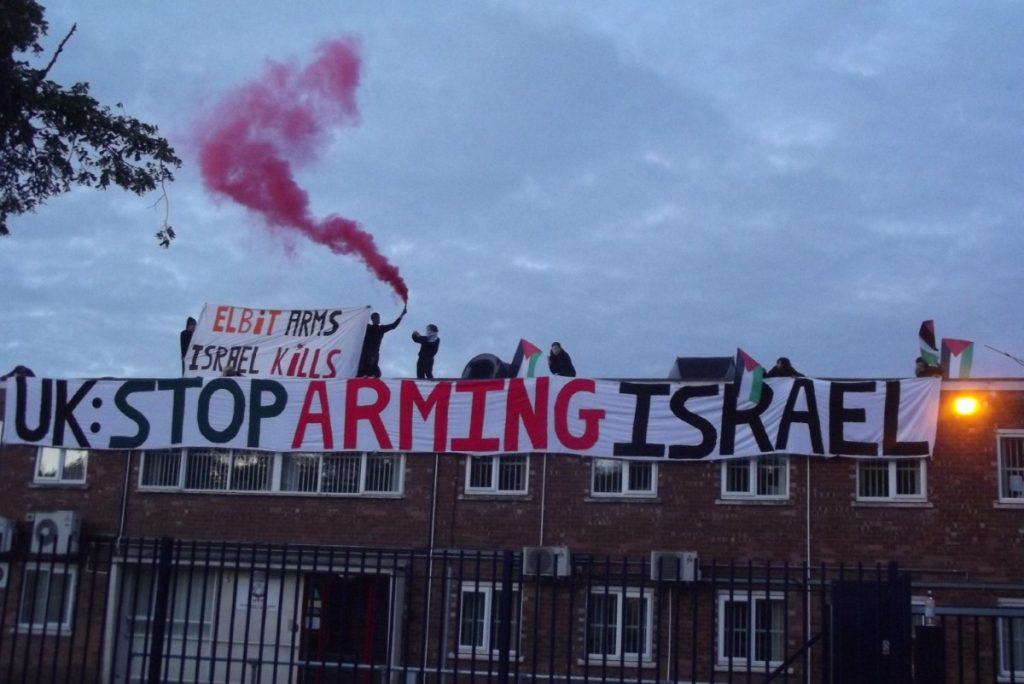 Pro-Palestinian activists on the roof of the factory this morning