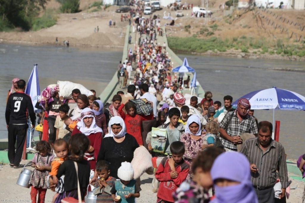 Yazidis flee unrest in northern Iraq, where around one million people have been displaced