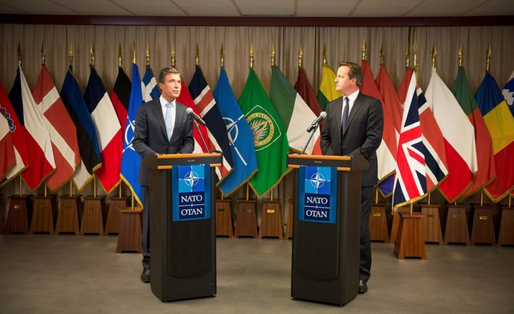 Nato secretary-general Anders Fogh Rasmussen and David Cameron 'still have work to do' before next month's summit