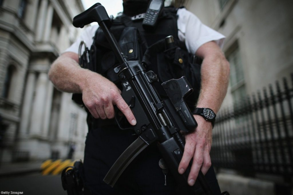 A police officer stands in Downing Street on the day Theresa May announced today the  terror threat level was being raised to 'severe'.