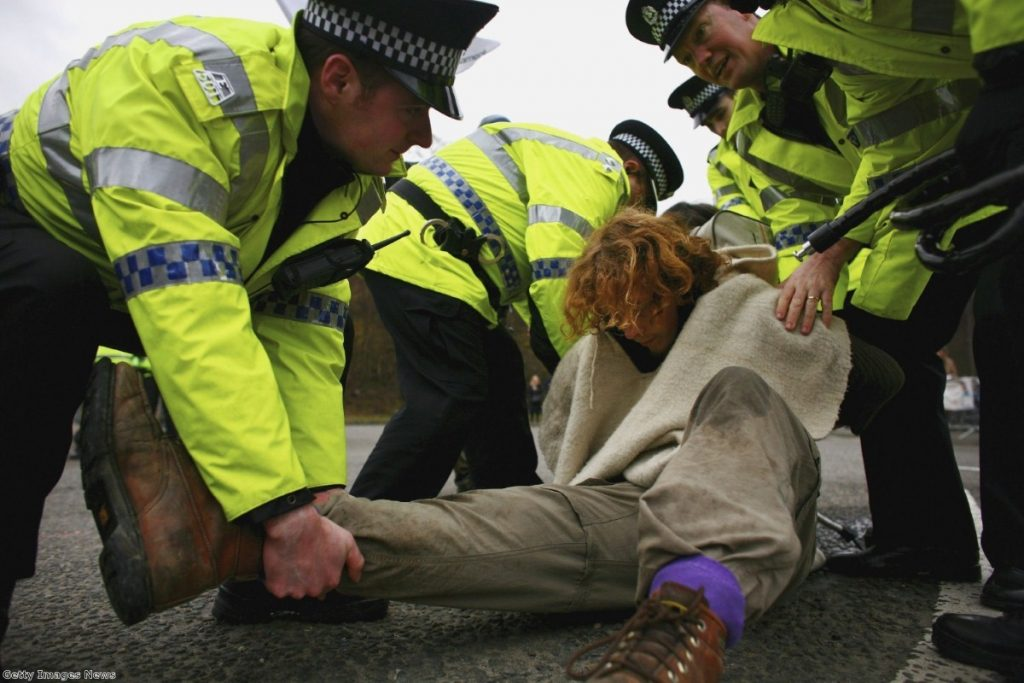 A campaigner is arrested during a protest at the Faslane naval base on the Clyde, home of Trident, in 2007.