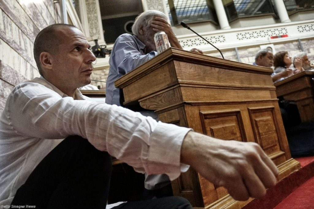 Greek finance minister Yianis Varoufakis attends a meeting as prime minister Alexis Tsipras addresses his party members and ministers at the Greek Parliament