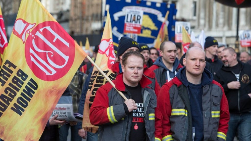 Members of the Fire Brigades Union on a protest march