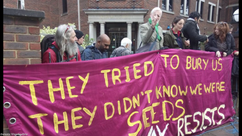 Campaigners from the Sweets Way Resists group outside court