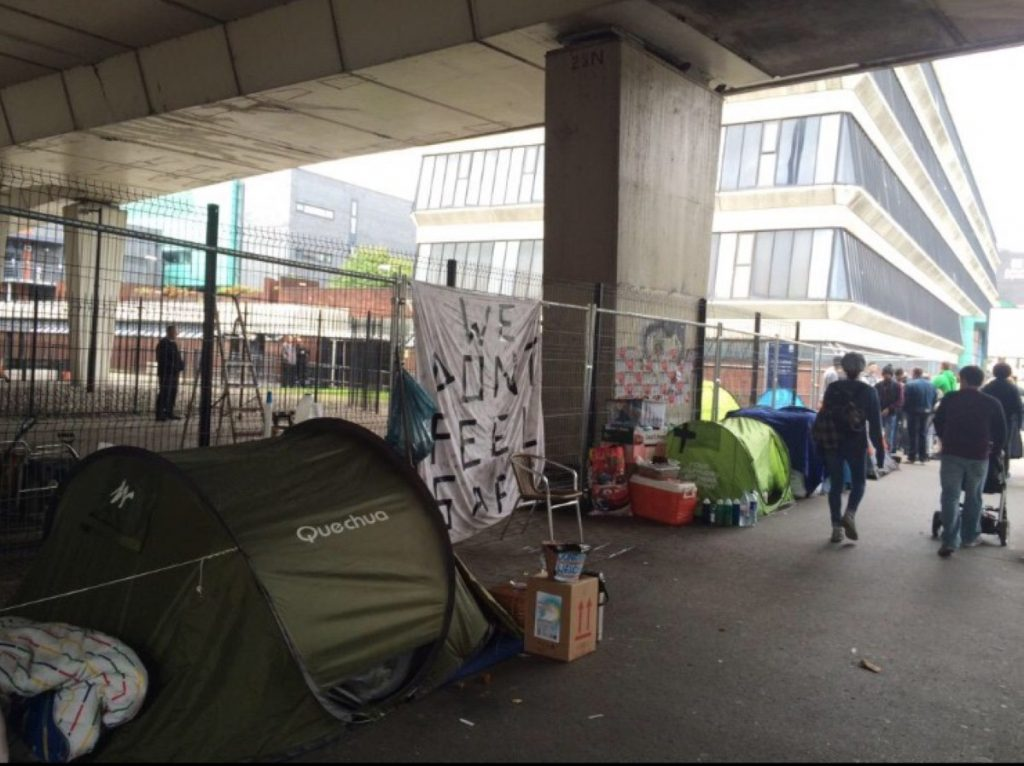 The group moved to the side of the road after being evicted from a bigger site which has now been fenced off