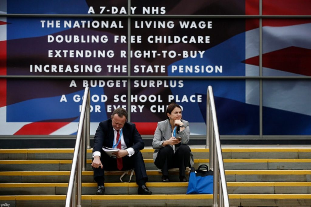 Delegates take a break outside the Conservative Party's annual conference in Manchester on Monday