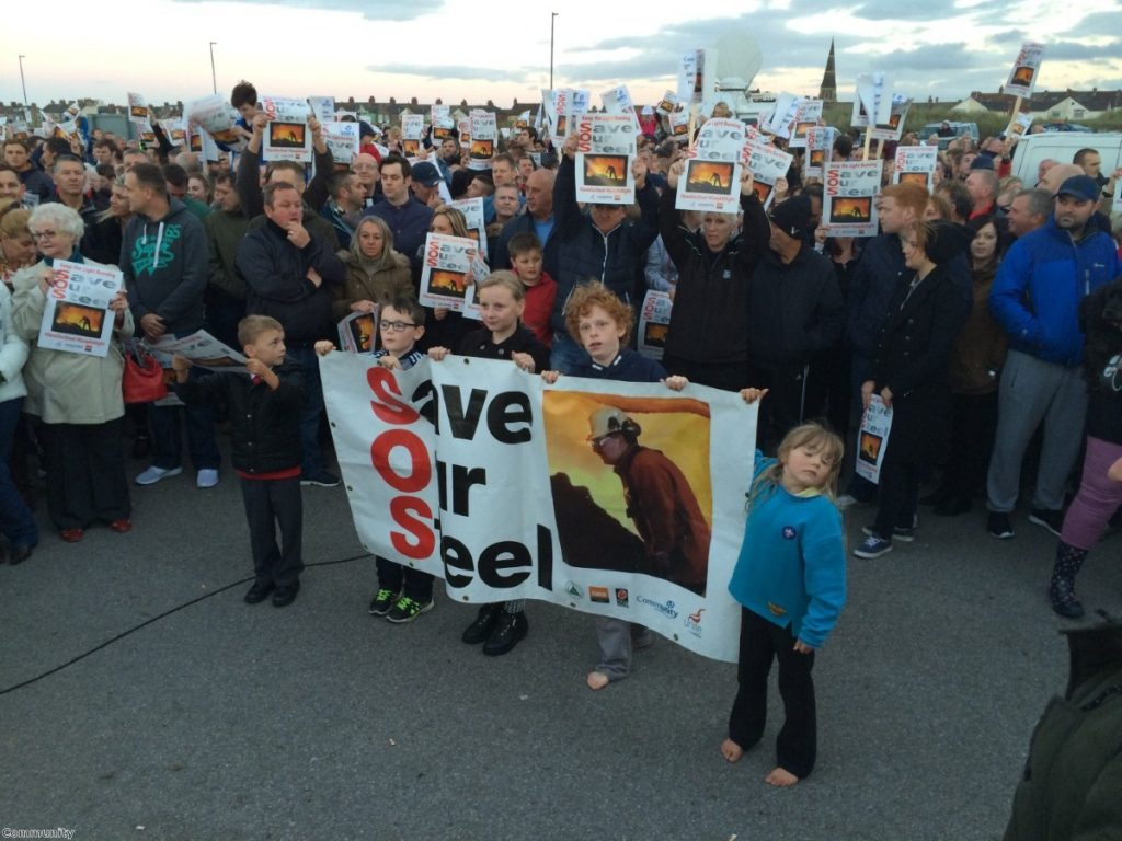 Workers hold a rally to save the British steel industry