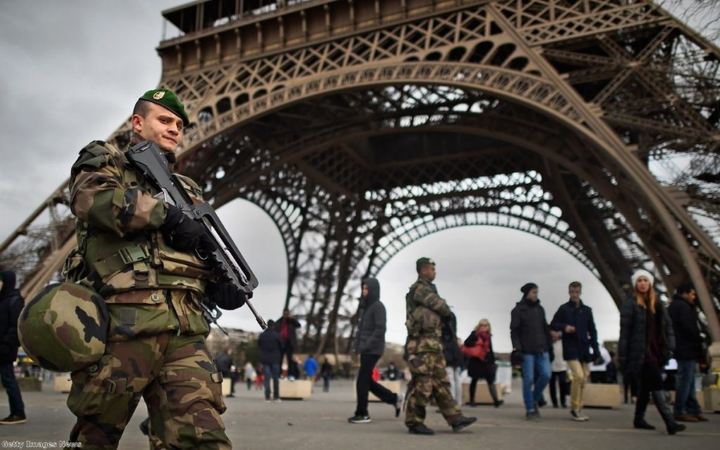 French troops patrol around the Eifel Tower on January 12, 2015