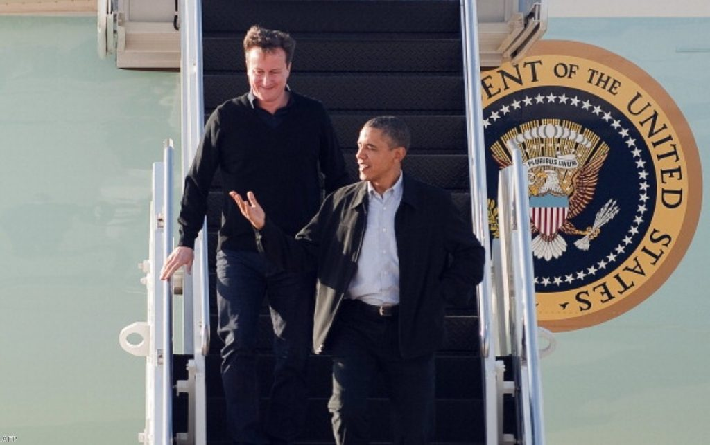 David Cameron looks on admiringly as Barack Obama leads him off Air Force One