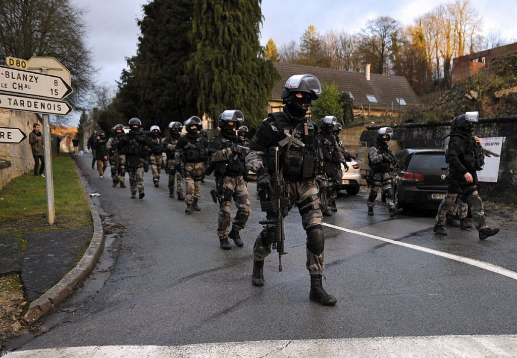 French police special forces carry out searches as part of an investigation into the Charlie Hebdo attack