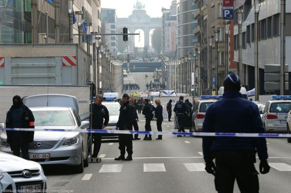 Police stand guard near a security perimeter in the Rue de la Loi near the Maalbeek subway station, in Brussels, after an explosion