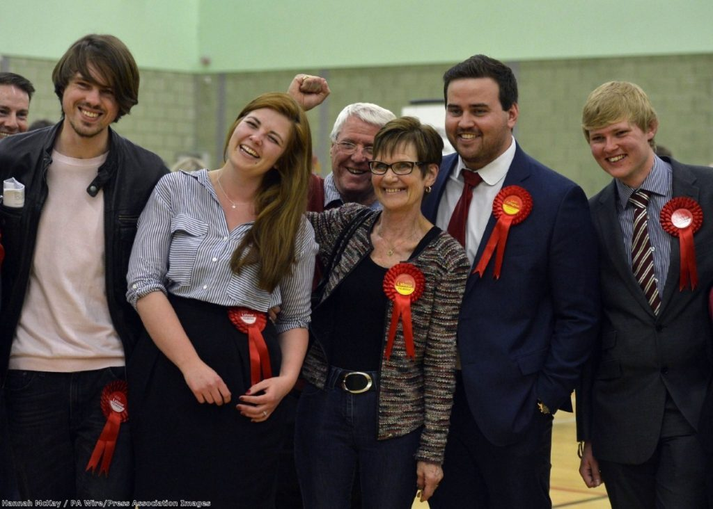 Party members celebrate after Kayte Block (second left) wins the Labour seat for Vange ward during the election count for Basildon