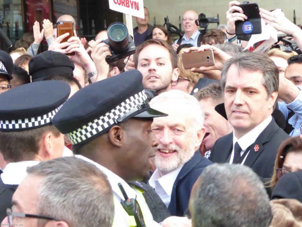 Jeremy Corbyn surrounded by supporters outside Parliament