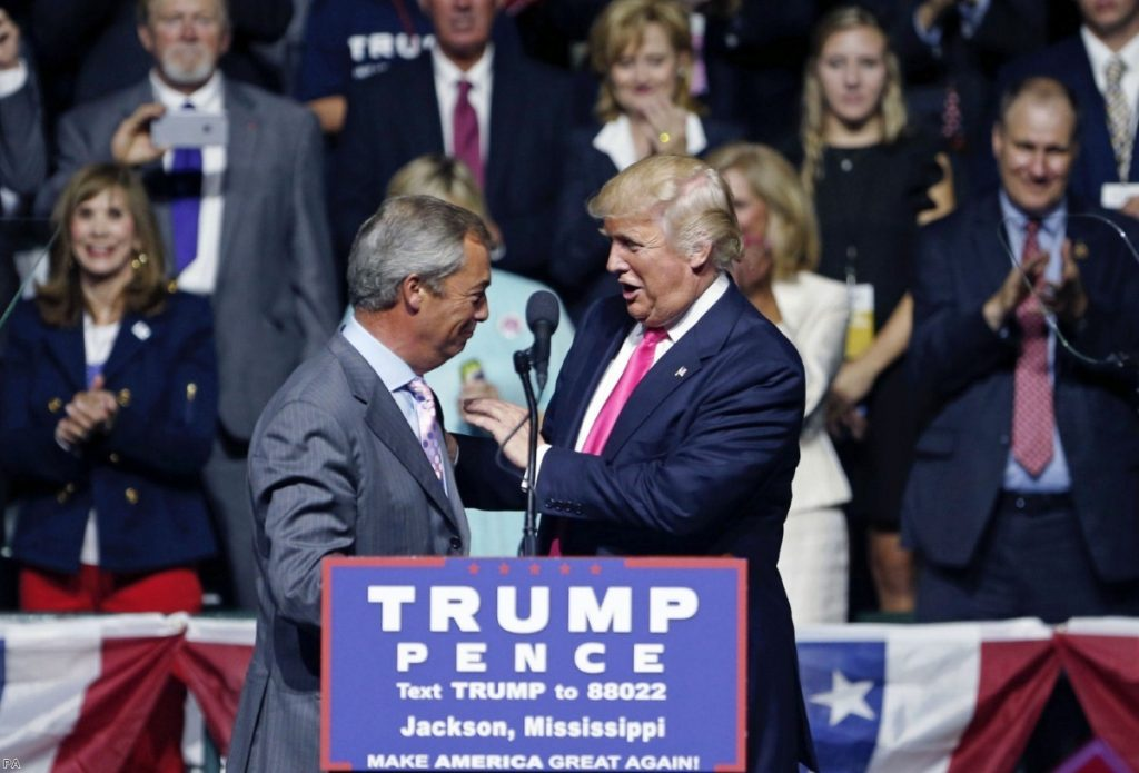 Donald Trump greets Nigel Farage to the stage in Mississippi